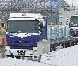 トラック出発の画像